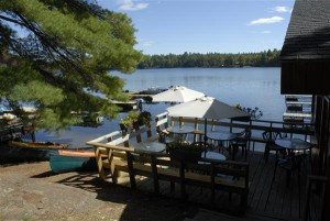 Deck outside restaurant at Blue Mountain Lodge overlooking Lake Kasshabog